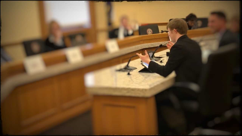 Self-Advocate Connor Long testifying before the Senate Committee
